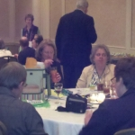 Image of conference attendees at a table