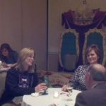 Robyn and Julia get pointers from our NCRA rep