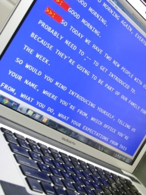 Image of an Apple laptop with CART text in white on a blue background